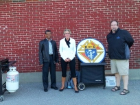 "Grand Knight Norman and Deputy Grand Knight Chris flank Sacred Heart School principal Anita Cairns at the ""Meet the Teacher BBQ"""
