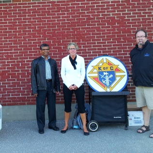 "Grand Knight Norman and Deputy Grand Knight Chris flank Sacred Heart School principal Anita Cairns at the ""Meet the Teacher BBQ"""