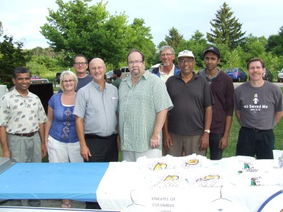 Fr. Vince and Leanne Moran join the brothers of Council 1429 for a picture at the Mass in the Park.