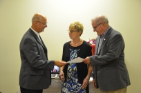 """George and Marg Weisz celebrate their 50th anniversary at Sacred Heart church on 11 Sep 2016. Fr. Vince Gullikers performed the renewal of vows at mass. He is seen here handing over the KofC """"A Covenant Renewed"""" certificate to the couple."""
