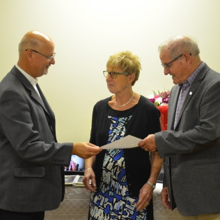 "George and Marg Weisz celebrate their 50th anniversary at Sacred Heart church on 11 Sep 2016. Fr. Vince Gullikers performed the renewal of vows at mass. He is seen here handing over the KofC ""A Covenant Renewed"" certificate to the couple."