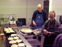 """Brothers David and Jerry busy whipping up pancakes at the St Pat's """"A Knight's Break"""" fundraiser for student awards and scholarships."""