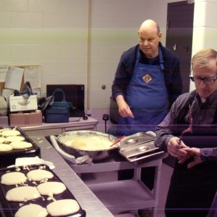 "Brothers David and Jerry busy whipping up pancakes at the St Pat's ""A Knight's Break"" fundraiser for student awards and scholarships."