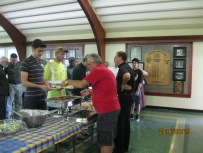 Brother Angelo Ferrari serves a World Youth Day pilgrim while Fr. Savel talks to another.