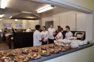 The wonderful servers - what enthusiasm! In the foreground, the 1st of 5 courses - Antipasto all set to be served.