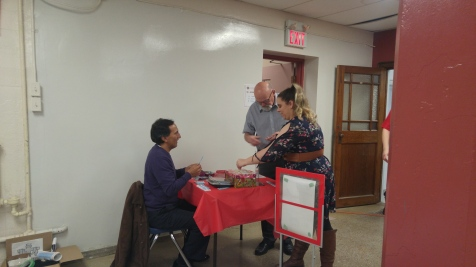 Chris Sanchez at the welcoming table